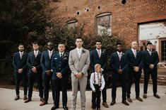 Love the contrast between the light gray groom suit to the deep navy groomsmen suits | Image by Wild Heart Visuals