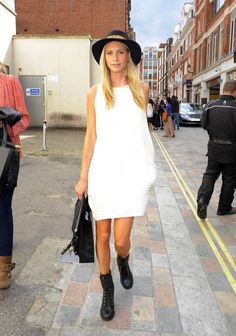 Poppy Delevigne at London Fashion Week.  Black boots.  White summer dress.