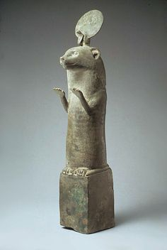 Bronze Otter statue: Egypt, Late Period or Ptolemaic Period, 664 -30 B.C.   During the Late Period and Ptolemaic times otters were represented in bronzes statuettes such as this one, standing, forepaws raised, atop small bronze boxes. The pose of raised paws signifies the otter's adoration of the sun god when he rises in the morning.  In myth, otters were attached to the goddess of Lower Egypt, Wadjet, whose cult was centered in Buto, in the northern Delta.
