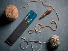 To wrangle all those items that run amok! This pencil case is made to fit up to 4 standard #2 pencils. It also easily fits pens, crochet hooks, a nail file, a comb, even a tire gauge! Outer is oil-tanned leather that will patina over time, and inner is lined with sueded pigskin. A