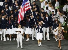 Opening Ceremonies: Flag bearer Mariel Zagunis of the U.S. holds the national flag as she leads the contingent in the athletes parade during the opening ceremony of the London 2012 Olympic Games at the Olympic Stadium