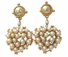 Vintage Chanel Pearl Heart Earrings   (Ok, knowing a bit about Mademoiselle, prob'ly fake, but here I don't care!)