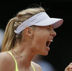 Maria Sharapova came through a tough battle with France's Kristina Mladenovic on Monday to make it into the second round at Wimbledon.
