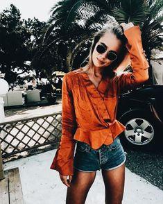949a2608145 Cute burnt orange blouse with denim shorts.