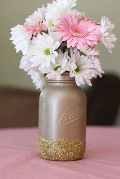 Glitter mason jar floral arrangements at a Twinkle Twinkle Little Star birthday party! See more party ideas at http://CatchMyParty.com!