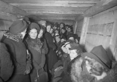 Helsinki women taking shelter under park. This photo is most likely from a precautionary exercise before the Winter War began. The women are smiling and look too happy to be actually under bombardment.  photo credit: Finnish Museum of Photography (not my caption)