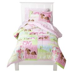 """This bedding set is the inspiration for the room. She looked at it, pointed to the cart, and said """"Mama put it in there!"""" I like that it isn't too sophisticated--this is a preschooler's room, after all."""