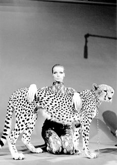 Veruschka cared too much to kill an animal for fashion. So, she resorted to carrying the leopard with her, like a very large, unpredictable pendant.   by William Klein, 1967