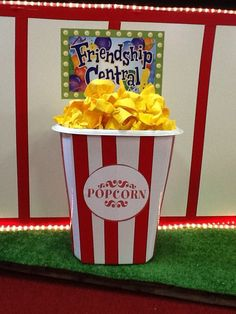 """Popcorn container using a white trash can and red duct tape - small cocktail napkins and twist ties were used to create the """"popcorn"""" Carnival Crafts, Carnival Ideas, Popcorn Containers, Fair Theme, After Prom, School Fair, Vbs 2016, Sports Day, Fun Fair"""