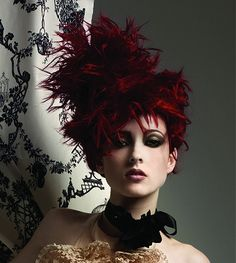 A long brown quirky avant garde straight coloured spikey hairstyle by Vivienne Mackinder
