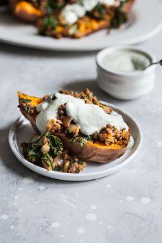 Smoky Lentil Kale Stuffed Sweet Potatoes with Pumpkin Seed Cream