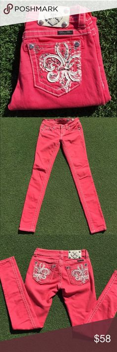 Pink Fleur de Lis skinny jeans Pink colored skinny jeans, with white accent stitching, designed with an embellished Fleur de Lis pattern on back pocket with silver logo hardware. Size 25, inseam 31. *small 3mm thread pull on left front (see last photo) No trades. Miss Me Jeans Skinny