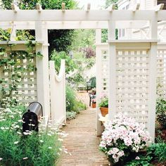 This nicely proportioned gate-and-arbor duo is set to the side of the home, allowing guests to bypass the front entry and head straight to the backyard. The structure provides virtually the same privacy and security as a fence but is far more charming.