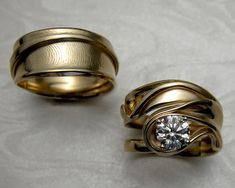 Matching free-form wedding set with ladies fingerprint on gents band. 14k yellow gold, diamond set in 4-prong setting.