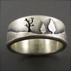 $325  Etsy listing at http://www.etsy.com/listing/115267755/mountain-forest-wedding-band-in-sterling