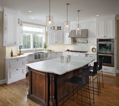 Transitional Kitchen in Washington Crossing, PA  White Paint & Cherry Cabinetry. Note the Stainless Steel Farm Sink.