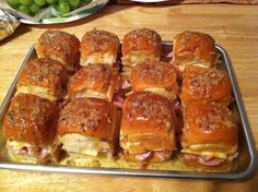 2 packages sweet hawaiian rolls  1.5 lb Virginia Ham  12 slices swiss cheese   1 stick butter  2 tsp Worcestershire sauce   1 tsp Garlic Powder  1 tsp Onion Powder  1 tsp poppy seeds  2 9 x 13 pans.   Place 2 slices ham on bottom of each roll. Cut cheese into fourths, place 2 pieces on each roll. Place the tops on. Mix butter, worcestershire sauce, onion powder, garlic powder and poppy seeds. Brush the melted mixture over rolls. Cover with foil, refridgerate 1 hr. Bake for 15 minutes at 375.
