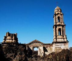 San Juan Parangaricutiro  Michoacán, Mexico.The crucifix-topped bell tower of the San Juan Parangaricutiro Church just so happened to be spared from the destructive volcano in 1943, while the vacated church's altar, at the other end of the church, is also entirely intact.