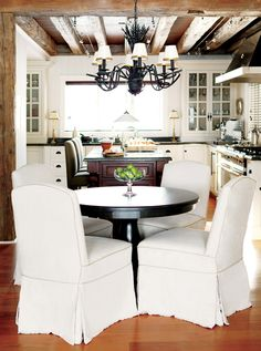 cottage classic kitchen.  not a fan of the chairs (i hate slipcovers) but love the rest :)