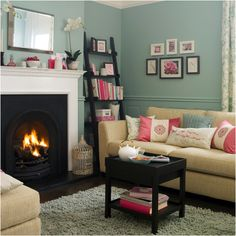 Smaller sized living area from a victorian terrace cottage. Lovely use of pastel shades. Gorgeous real log fire place.