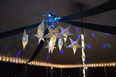 Paper star lanterns chandelier.   Dancing under the stars.