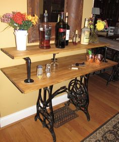 "Top Cycled and Repurposed Rustic Industrial Bar Desk Table Curio stand made from Antique Cast Iron Sewing machine. 48 "" wide x 20 "" deep and 36"" tall. Reasonable offers are entertained. You can see this at our store on Ebay.com timsantiques or Etsy.com timsantiques1"