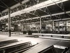 Interior of Camberwell LT tram depot (later Walworth bus garage). A line of E/1-class trams, including nos 1886, 1885, 1889, 1516 and 1517 can be seen. A traverser stands over its pit, mid-ground centre. Empty stabling roads are visible in the foreground.  Photographed by Topical Press, 20 Aug 1936. Photograph 1998/87747 - Photographic collection, London Transport Museum