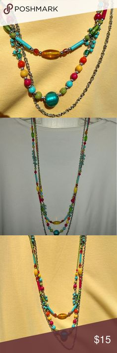 Necklace Turquoise silver Long, 3 strand necklace, as shown in photos.  Colors are yellow, turquoise, orange, lime and a rose pink.  Metal is silver colored. Jewelry Necklaces