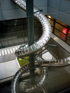 This is the best kind of installation art. Slide by Carsten Holler - Museum of Contemporary Art in Zagreb, Croatia: This is a double slide with two intertwined helical tubes transporting riders from the 3rd floor to the outside.