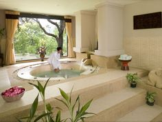 Spa bath.  Love the steps....Every home should have a bathroom like this!