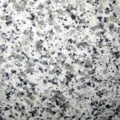 BIANCO SARDO CHINA. Fine flecks of black and grey on a white background. Gorgeous granite color available at Knoxville's Stone Interiors.  Showroom located at 3900 Middlebrook Pike, Knoxville, TN.  www.knoxstoneinteriors.com  FREE Estimates available, call 865-971-5800.