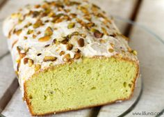 Frosted Pistachio Bread recipe on { lilluna.com } So soft and delicious! Recipe includes a box of yellow cake mix, pistachio pudding mix, & sour cream drizzled with a yummy glaze and chopped pistachio's.