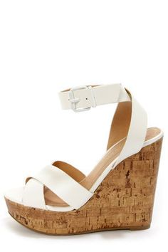 ... Olio White Platform Wedge Sandals will see you through with  crisscrossing vegan leather toe straps forming a cute peep toe and a  matching ankle strap. ed49548829d59