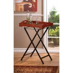 The grace of bygone days and timeless style can warm your home to both you and your guests. This welcoming tray table features a pine wood tray that has a handcrafted charm about it, and the folding metal stand makes it easy to tuck away when not in use. Contents not included. #freeshipping
