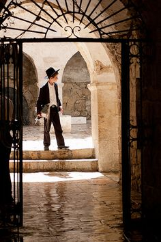 Young Jewish boy on the old streets of ancient Jerusalem. He is probably returning from his Torah studies. www.facetozion.com