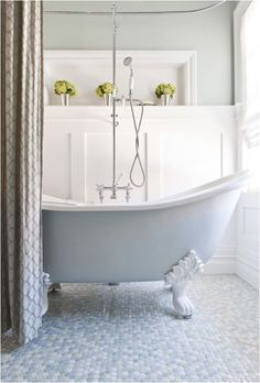 Board and batten with cubby above. pale blue clawfoot tub