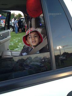 Zachy as a passenger in the cruiser.