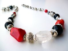 I like the silver with coral, could do this with turquoise. Red and Black Chunky Gemstone Necklace Red by BigSkiesJewellery, $32.00
