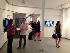 """Elias Crespin, Circuconcéntricos Blanco y Rojo, 2013. View of the exhibition """"Art cinétique, art numérique"""", Galerie Denise René Espace Marais, Paris during the opening. Photo Atelier Crespin"""