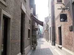 "Shanghai: ""Renovated shikumen lanes in Xintiandi, now a high-end restaurant and shopping center"""