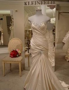I'm definitely going with an Ivory dress! And it has to be mermaid style.