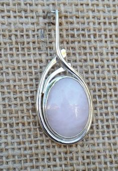 Simple, flowing Sterling Silver holding pink quartz....only $120.00 with chain. I found this really awesome Etsy listing at https://www.etsy.com/listing/205320242/sterling-silver-pendant-with-chain