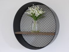 Mesh backed metal round industrial shelf.
