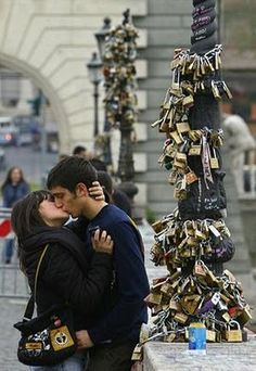 "Ponte Milvio bridge in Italy where lovers go an leave a lock on the bridge...the bridge is covered with ""Love Locks"". Must be cool to see...very romantic!"