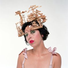 Isabella Blow models a hat based on a Japanese temple by Philip Treacy for Alexander McQueen. Photograph: Richard Saker/Rex Features