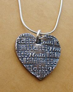 a heart for Haiti. proceeds of this necklace go to a family adopting from Haiti.