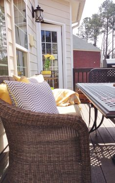 Customize your outdoor furniture to fit your family's personality and style. I added throw pillows from HomeGoods for a fresh new look! #HomeGoods #HappyByDesign #sponsored