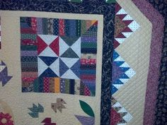Wool quilt made by Shirley. Longarm quilted by Le Ann Weaver of www.persimmonquilts.com