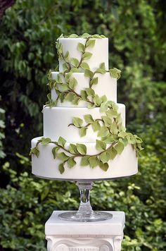 This four-tiered white wedding cake features fondant branches that ascend to the top layer- fabulous for a wedding in the garden.