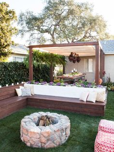 Fire pit and outdoor dining. I like the planters behind the bench
